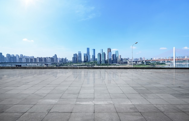 Panoramic skyline and buildings with empty concrete square floor Free Photo