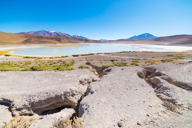 Panoramic view of  frozen salty lake on the way to the famous uyuni salt flat Premium Photo