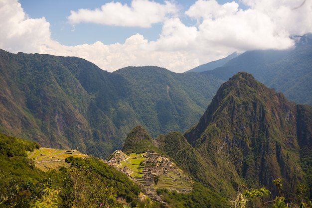 Panoramic view of machu picchu, illuminated by afternoon sunlight,  from the inca trail to the sun gate. Premium Photo