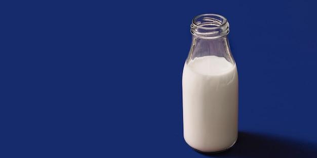 Panoramic view of opened milk glass bottle Free Photo