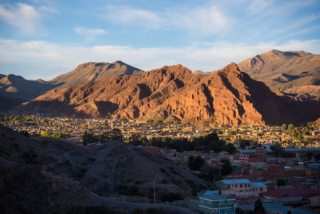 Panoramic view of tupiza village with glowing red mountain range at sunset. from here start the outstanding 4 days road trip to uyuni salt flat, among the most important travel destination in bolivia. Premium Photo