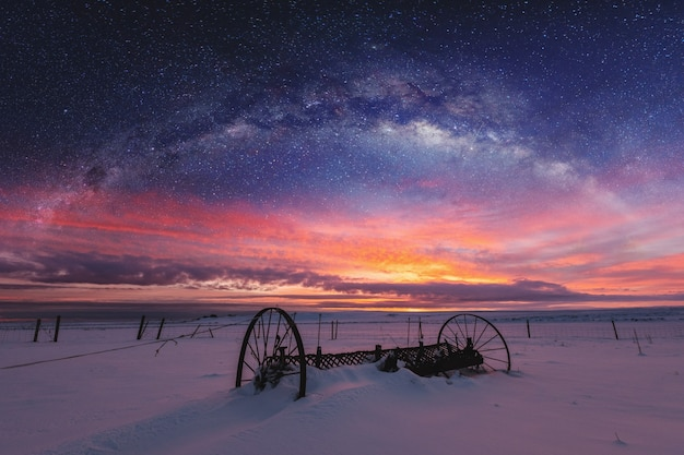 Panoramic winter landscape in sunrise with double exposure night sky landscape Premium Photo