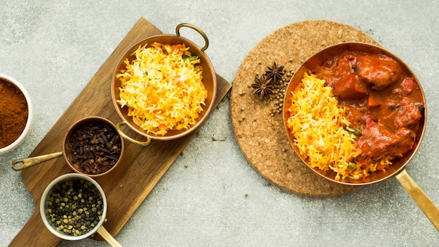 Pans with rice and spices on boards Free Photo