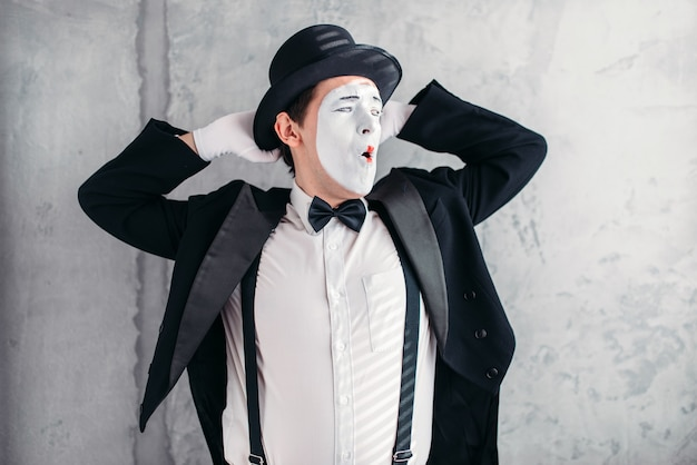 Pantomime artist with makeup mask. mime in suit, gloves and hat. Premium Photo