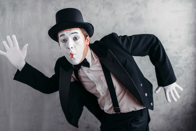 Pantomime theater artist posing, mimic male person with white makeup mask. Premium Photo