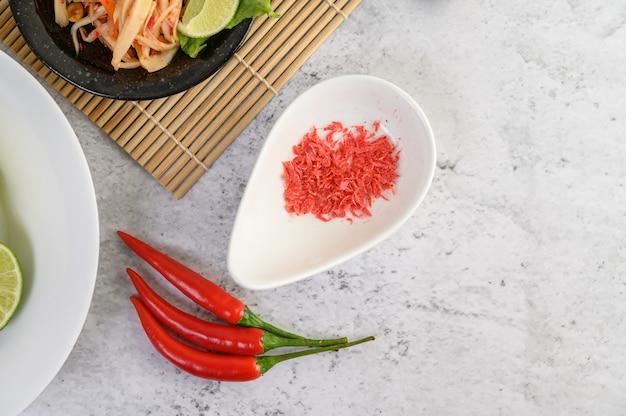 Papaya salad with chili peppers Free Photo