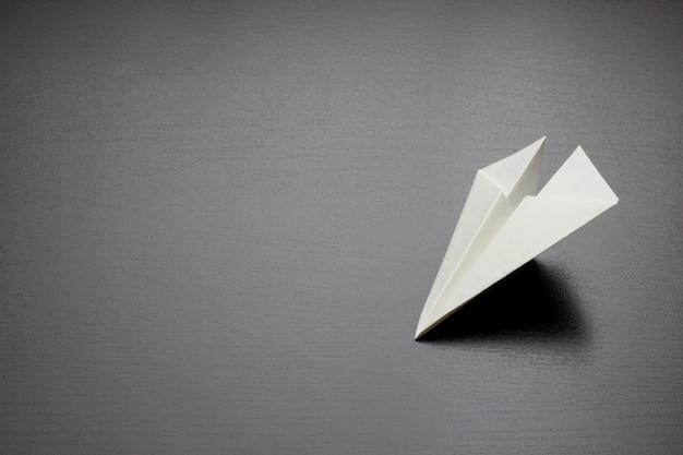 Paper air plane on dark background for design Premium Photo