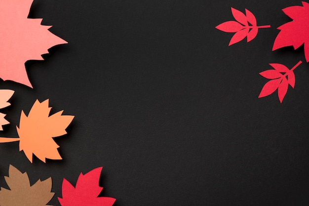 Paper autumn leaves composition with copy space Free Photo