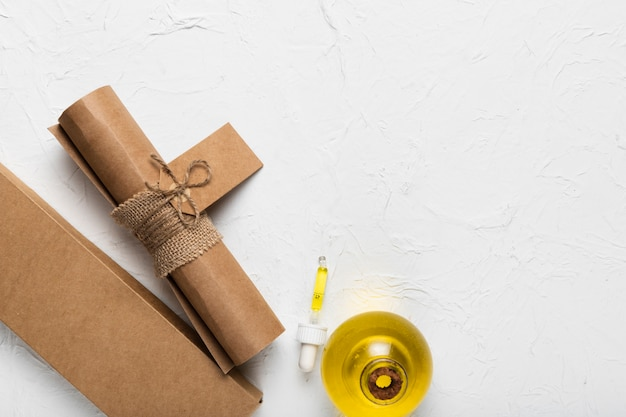 Paper bag and balmy oil at spa Free Photo