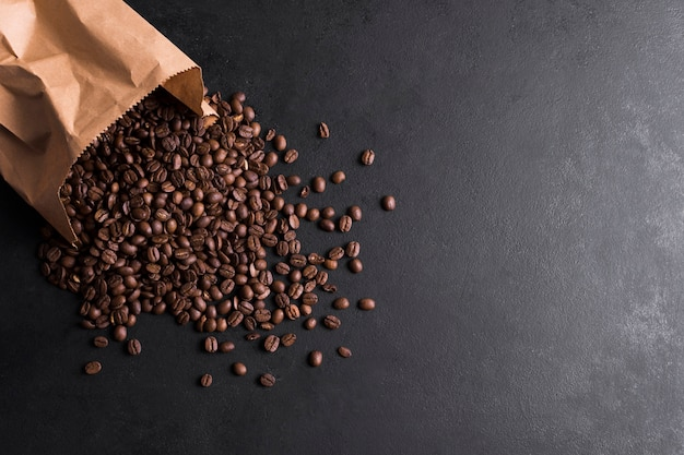 Paper bag filled with coffee beans Free Photo