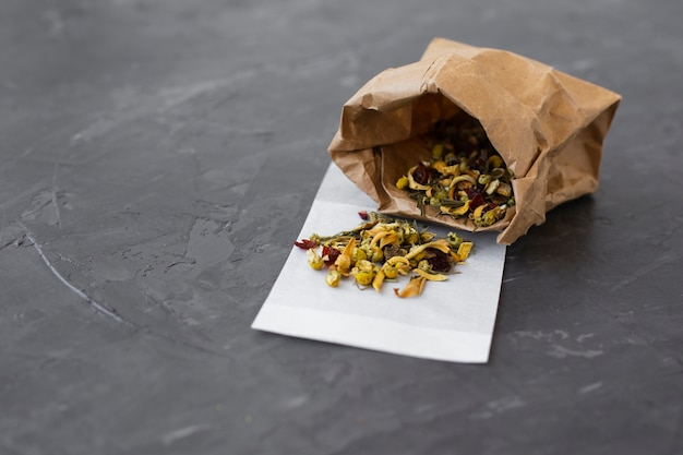Paper bag filled with colorful tea buds Free Photo