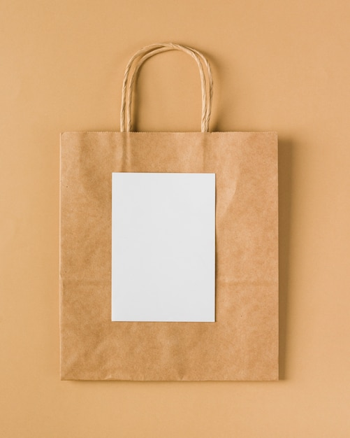 Paper bag with blank paper Free Photo