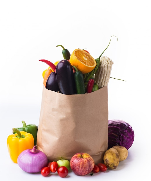 Paper bag with vegetables Free Photo
