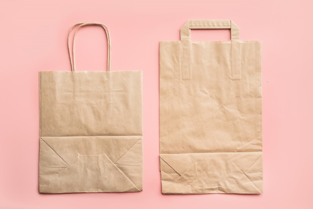Paper bags for zero waste shopping on pink. Premium Photo
