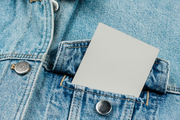 Paper card in jeans pocket on jeans clothes Premium Photo
