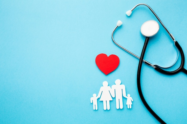 Paper chain family with heart and stethoscope Free Photo