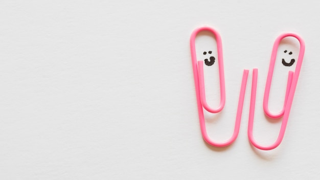 Paper clips with draw faces Free Photo