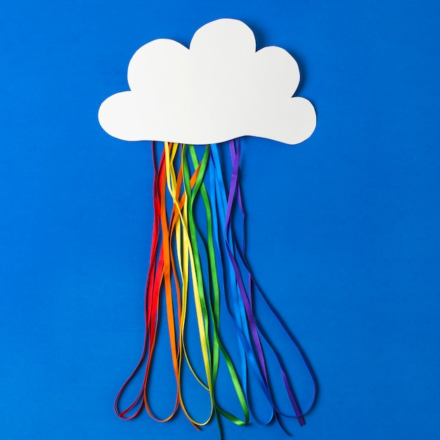 Paper cloud with colorful tinsels in lgbt colors Free Photo