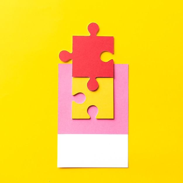 Paper craft art of jigsaw puzzle piece Free Photo