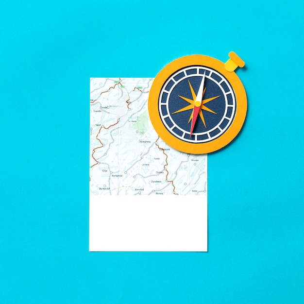 Paper craft art of a map and compass Free Photo