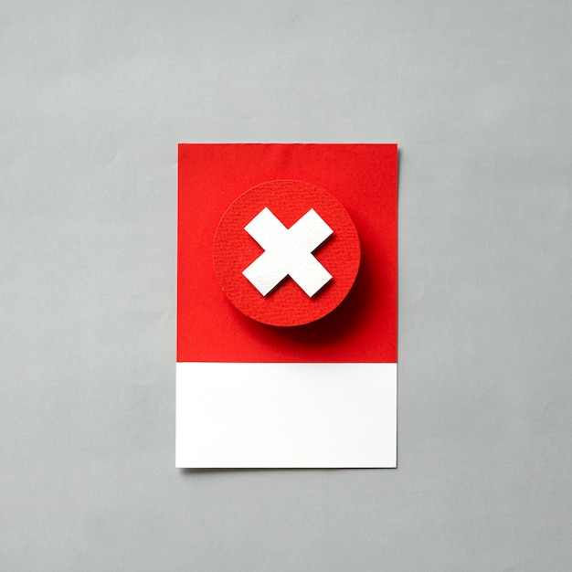Paper craft art of a red x Free Photo