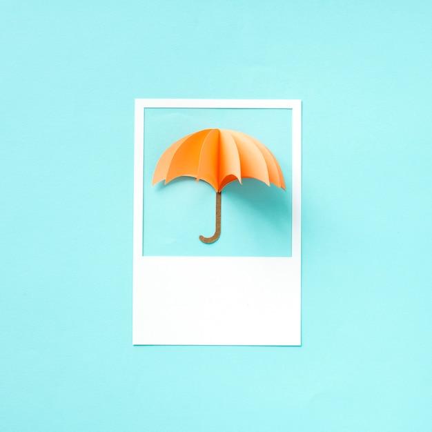 Paper craft art of an umbrella Free Photo