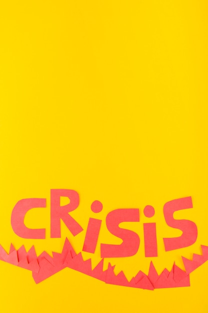 Paper crisis lettering on yellow background Free Photo