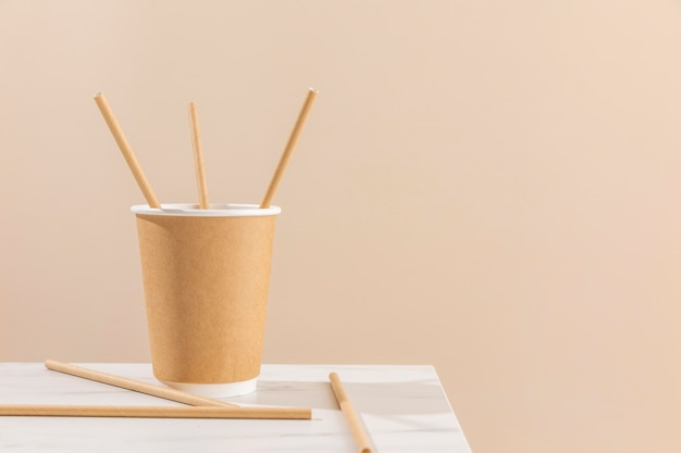Paper cup and straws arrangement Free Photo