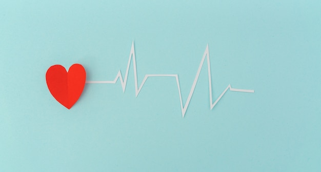 Paper cut of cardiogram of heart rhythm for valentines day . Free Photo