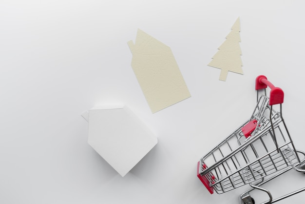 Paper Cut Out House And Christmas Tree With Miniature