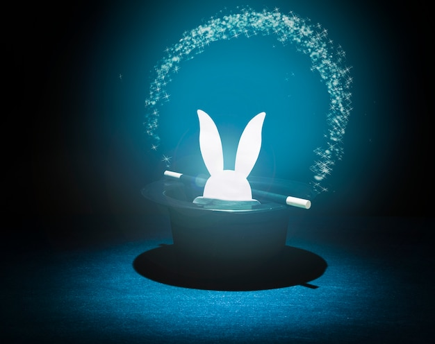 Paper cut out rabbit heads in the top black hat with glowing star arch Free Photo