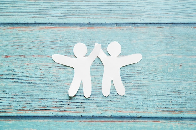 Paper cut people on blue background Free Photo