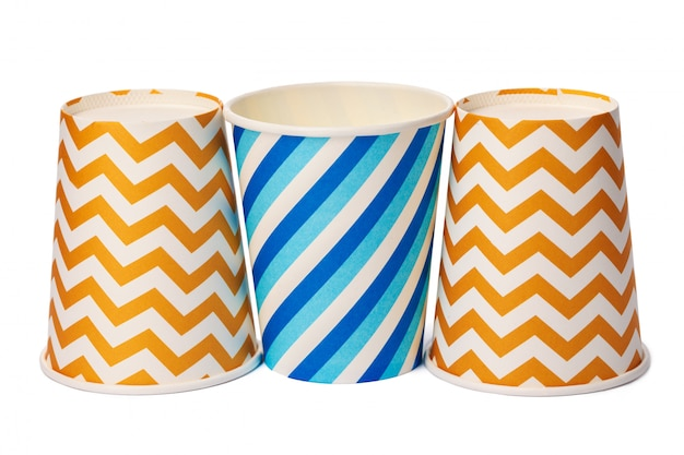 Paper disposable cups with colored pattern isolated on white background Premium Photo