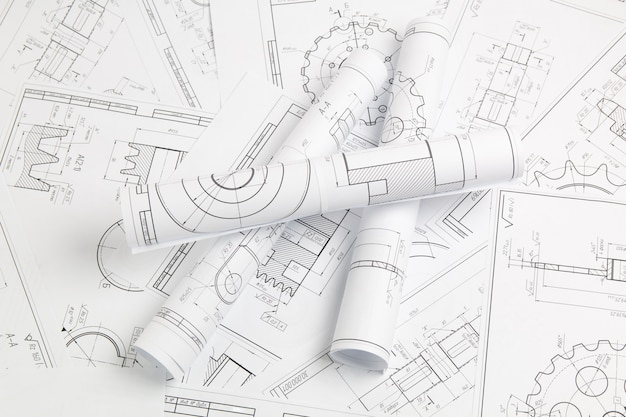 Paper engineering drawings of industrial parts and mechanisms Premium Photo
