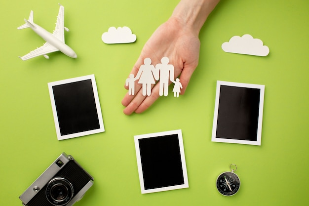 Paper family with instant photos and camera Free Photo