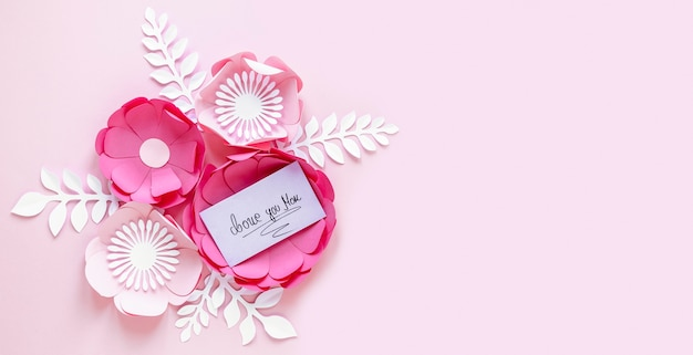 Paper flowers for mother's day with copy-space Free Photo