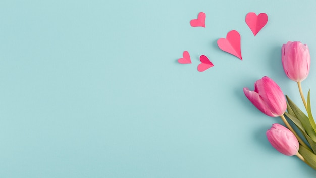 Paper hearts and bunch of flowers Free Photo