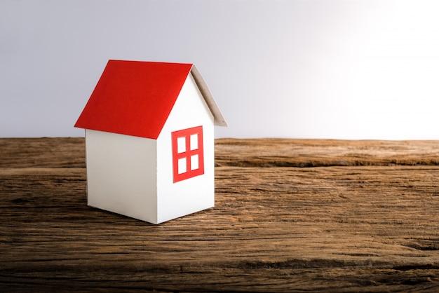 Paper house symbolizing Premium Photo
