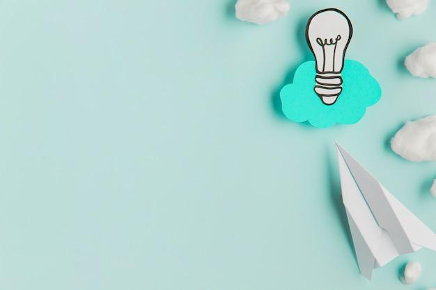 Paper light bulb and airplane Premium Photo