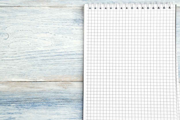 Paper notebook with space for text on a light blue old wooden background. Premium Photo