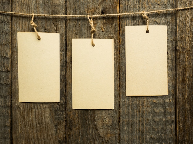 Paper notes on rope on wooden background. copy space. Premium Photo