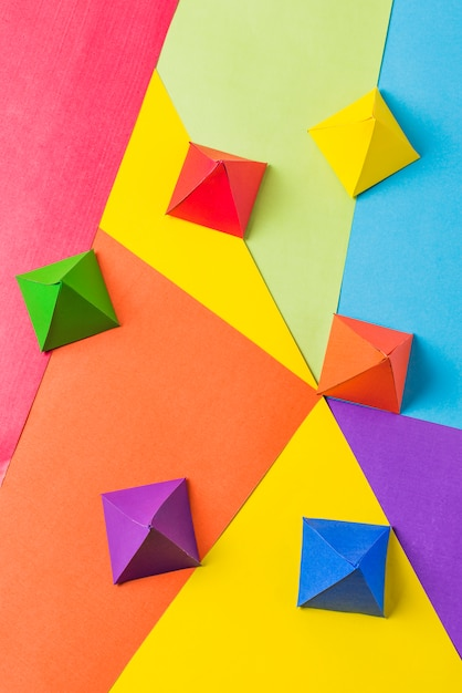 Paper origami pyramids in bright lgbt colors Free Photo