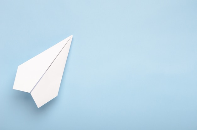 Paper plane on a blue background Premium Photo