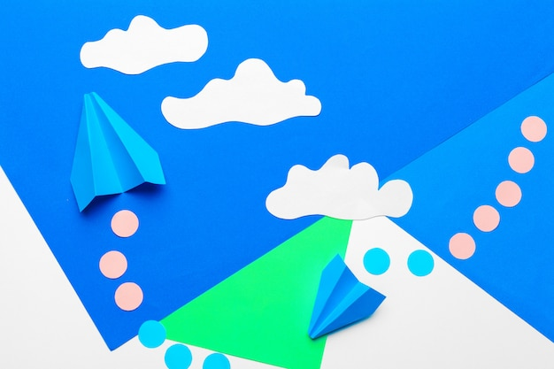 Paper plane  on a blue with clouds Premium Photo