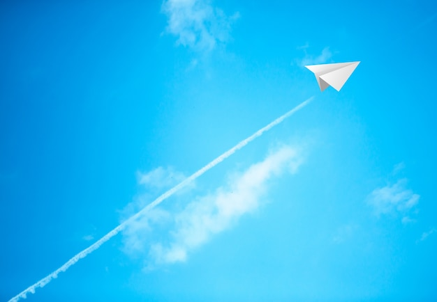 Paper planes in blue sky Free Photo