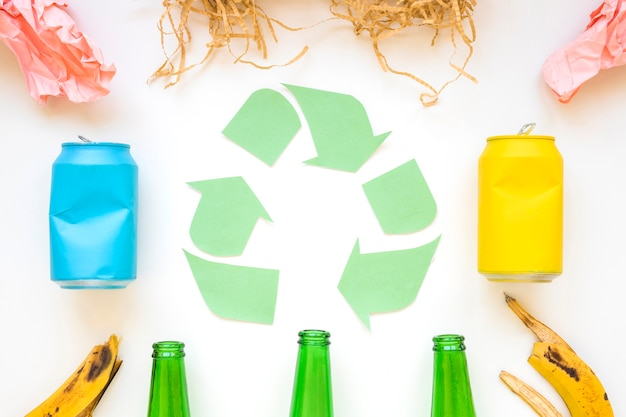 Paper recycle logo with colorful garbage Free Photo