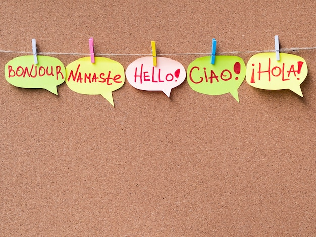 Paper speech bubbles with hello in different languages Free Photo