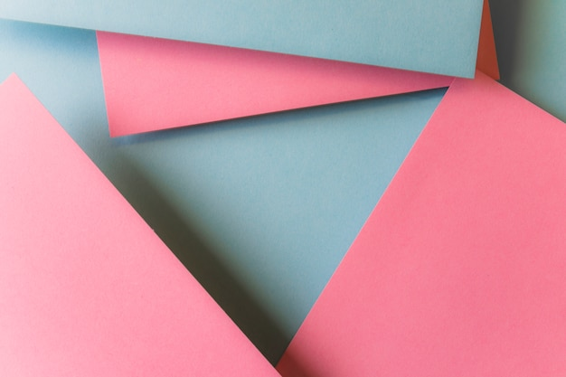 Paper triangle shapes layered in abstract modern art style background pattern Free Photo