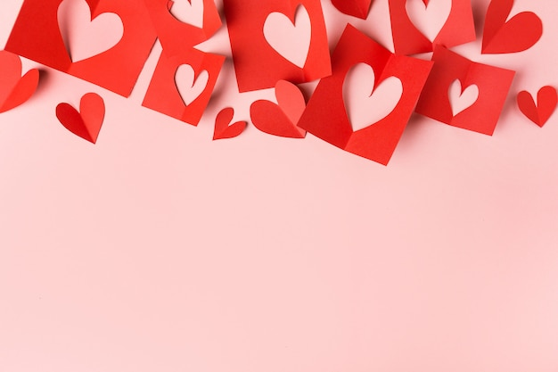 Paper valentines day hearts on pink Free Photo