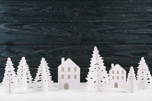 Paper winter city on wooden background Free Photo
